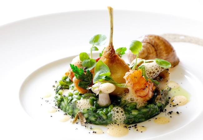 Chef Michael Caines | A dish of frog's legs and crayfish with snails, nettle, and wild garlic risotto